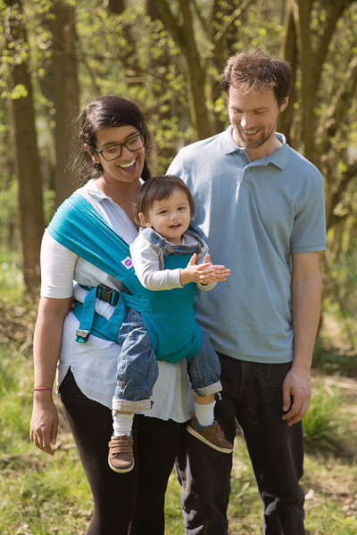 Izmi_Baby_Carrier_Cotton_Teal_Lifestyle_Front_Facing_Carry_Couple_In_Woodland.jpg