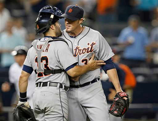 . Detroit Tigers relief pitcher Joe Nathan, right, congratulates catcher Alex Avila (13) after Nathan closed out the New York Yankees in the 12th inning of the Tigers\' 4-3 win in 12 innings in a baseball game at Yankee Stadium in New York, Tuesday, Aug. 5, 2014. Avila hit the go-ahead home run. (AP Photo/Kathy Willens)