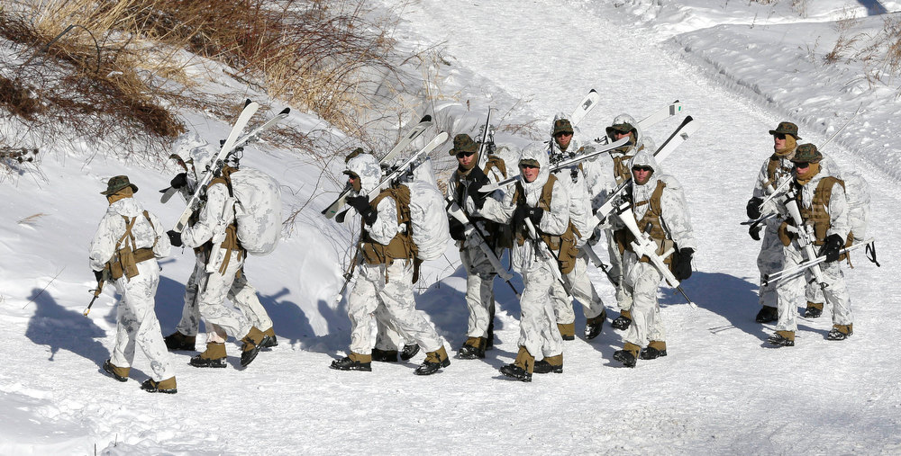 . U.S. Marine from 3-Marine Expeditionary Force 1st Battalion from Kaneho Bay, Hawaii, carry their guns and skies during their joint exercise with South Korean counterparts in Pyeongchang, east of Seoul, South Korea, Thursday, Feb. 7, 2013. More than 400 marines from the two countries participated in the Feb. 4-22 joint winter exercise held for the first time in South Korea. (AP Photo/Lee Jin-man)