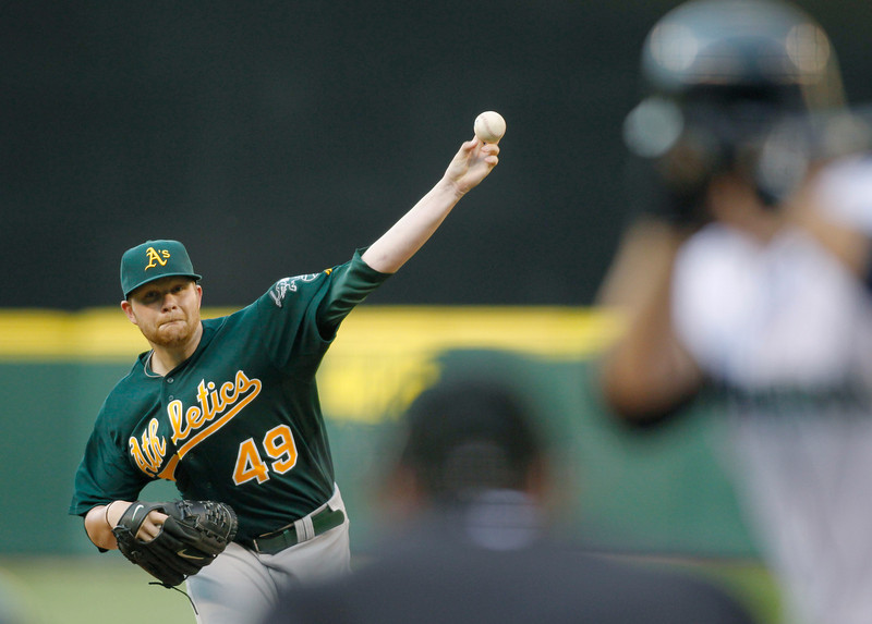 . Oakland Athletics\' Brett Anderson works against the Seattle Mariners during the first inning of a baseball game in Seattle on Saturday, Sept. 8, 2012. (AP Photo/John Froschauer)