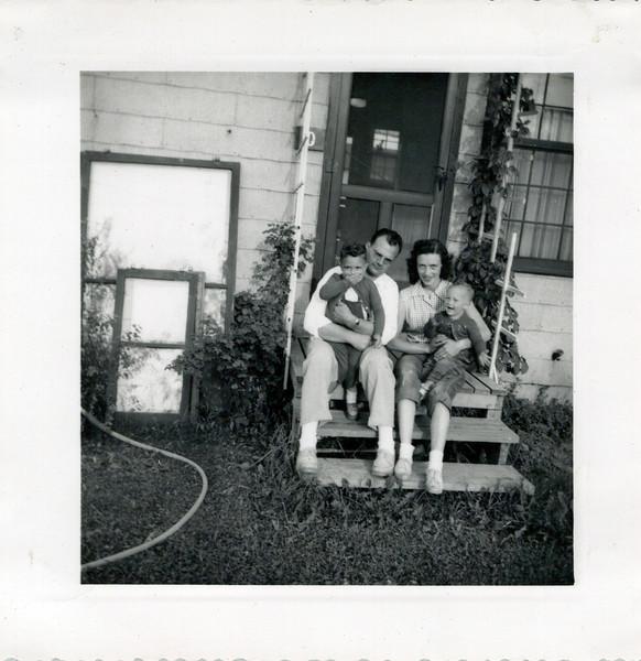 1952 Doc, Butch, Viv and Ken on front steps.jpeg
