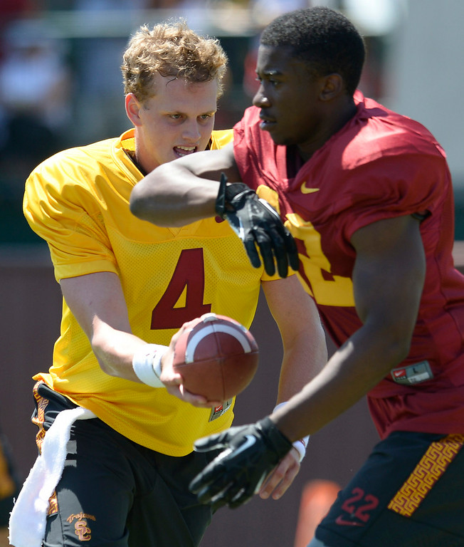 . QB Max Browne hands the ball off to Justin Davis. Football practice is in full swing on the Howard Jones Field at USC. Los Angeles, CA. 8/6/2014(Photo by John McCoy Daily News)