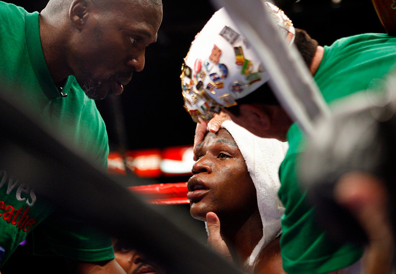 . Floyd Mayweather Jr. listens to his uncle Roger Mayweather during his fight against Oscar De La Hoya for the WBC super welterweight world championship boxing match on Saturday, May 5, 2007, at the MGM Grand Garden Arena  in Las Vegas.  Mayweather Jr. won via 12 rd. split decision.  (AP Photo/Kevork Djansezian)
