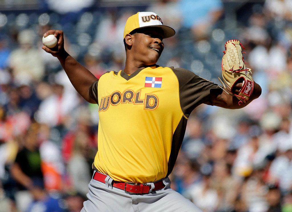 . World Team starting pitcher Alex Reyes, of the St. Louis Cardinals, throws against the U.S. Team during the first inning of the All-Star Futures baseball game, Sunday, July 10, 2016, in San Diego. (AP Photo/Matt York)