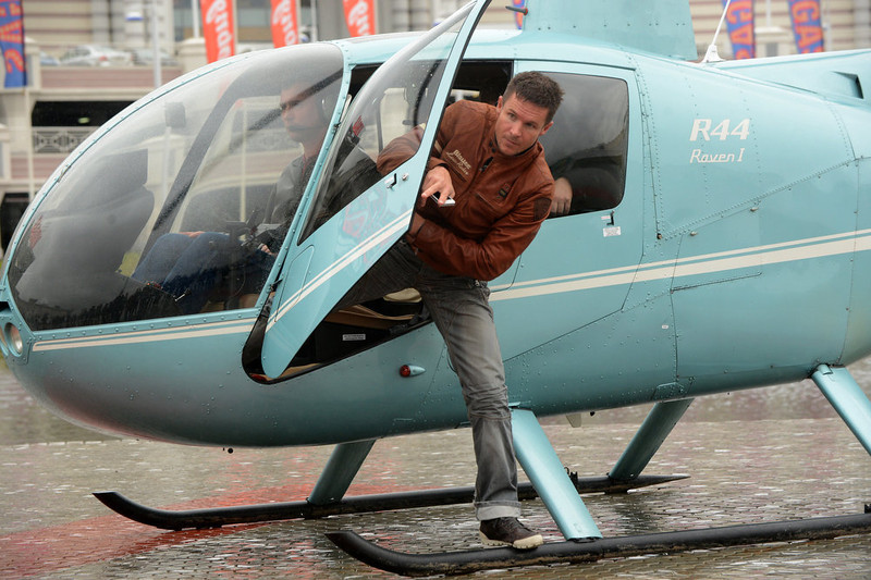 . Austrian skydiver Felix Baumgartner, gets off a helicopter as he arrives for a ceremony to get his own Walk of Fame star in Moscow, on November 9, 2012. Last month Baumgartner jumped out of a balloon from 128,000 feet above New Mexico, breaking the record for the highest ever freefall, and was the first skydiver to break the sound barrier. Felix Baumgartner ranked as Google\'s sixth most searched trending person of 2012. KIRILL KUDRYAVTSEV/AFP/Getty Images