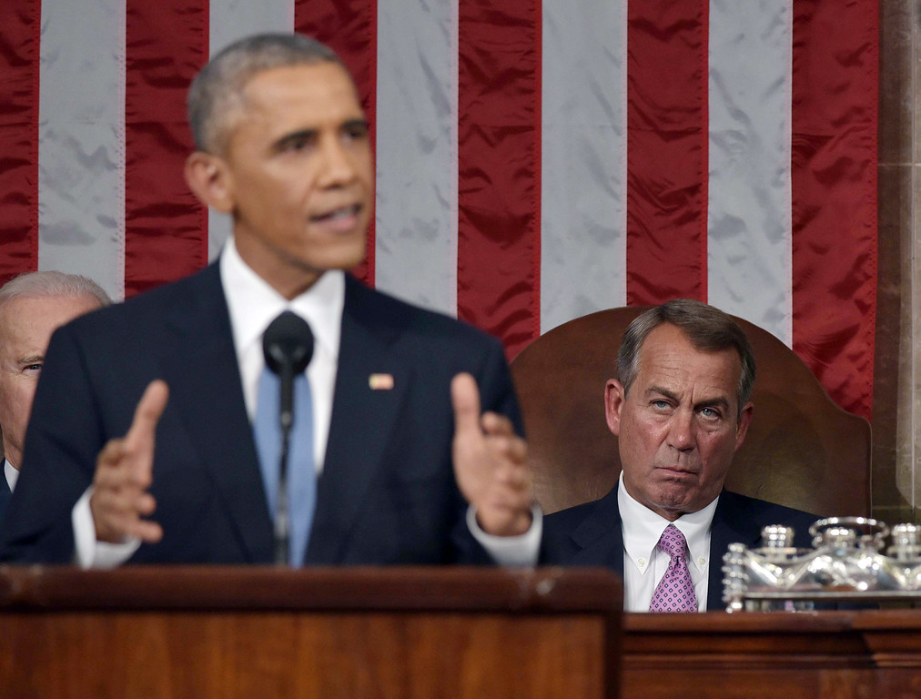 . President Barack Obama delivers his State of the Union address to a joint session of Congress on Capitol Hill on Tuesday, Jan. 20, 2015, in Washington, as  House Speaker John Boehner of Ohio, listens in the background. (AP Photo/Mandel Ngan, Pool)