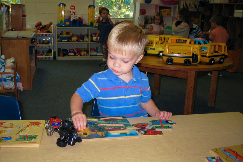 Ethan plays with a Thomas puzzle on his 1st day of pre-school.