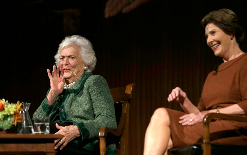 . Former first ladies Barbara Bush, left, and Laura Bush speak during the Enduring Legacies of America�s First Ladies conference Thursday, Nov. 15, 2012, in Austin, Texas. Family members, former staff members, historians, and White House insiders also spoke as part of the program. (AP Photo/David J. Phillip)