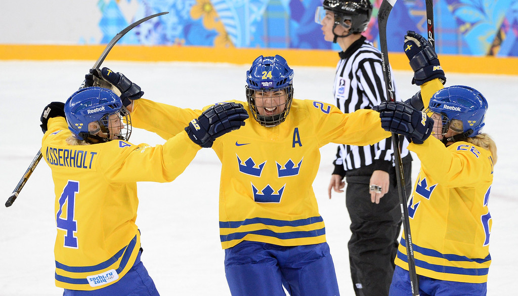 . Sweden\'s Erika Grahm (C) celebrates after scoring a goal with teammates Jenni Asserholt (L) and Emma Eliasson during the Women\'s Ice Hockey Group B match Sweden vs Japan at the Shayba Arena during the Sochi Winter Olympics on February 9, 2014.   ANDREJ ISAKOVIC/AFP/Getty Images