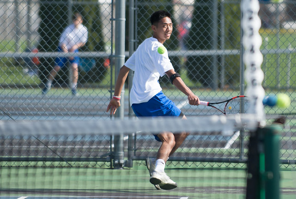 04/17/19 Wesley Bunnell | Staff Southington boys tennis hosted Berlin on Wednesday afternoon at Southington High School. Southington's Matt Balaoing.