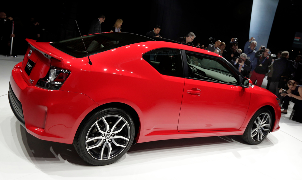 Description of . The 2014 Scion tC is presented at the New York International Auto Show, in New York's Javits Center,  Thursday, March 28, 2013. (AP Photo/Richard Drew)