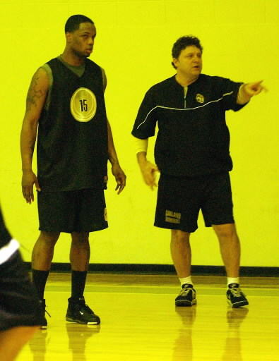 . Oakland University men\'s basketball player Rick Billings, left, gets instruction from head coach Greg Kampe during practice, Sunday, March 4, 2007, at the Mabee Center, on the campus of Oral Roberts University in Tulsa, OK.  (The Oakland Press/Jose Juarez)