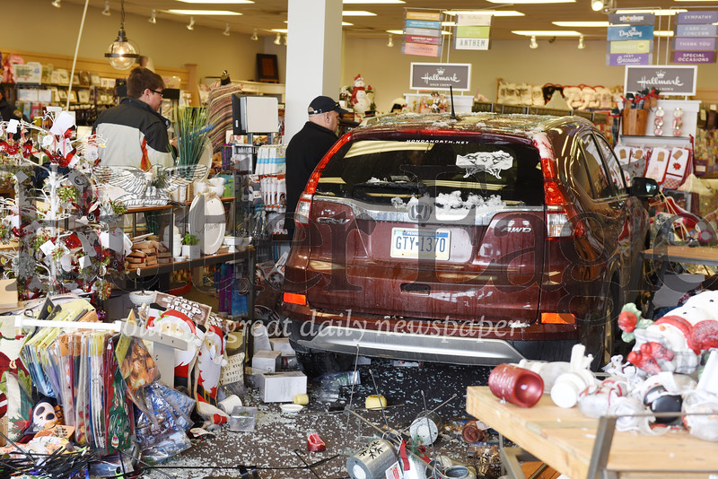 Harold Aughton/Butler Eagle: Medical personnel tend to a woman, who drove her Honda CR-V throught the window of the Hallmark store front at Butler Commons Wed., Nov. 13, 2019.