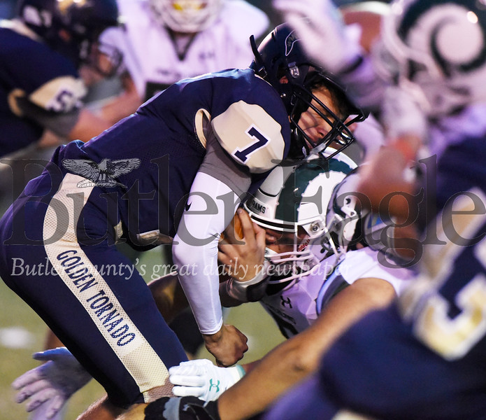 Harold Aughton/Butler Eagle: Butler quarterback Cooper Baxter is stopped for no gain in the first quarter against Pine-Richland.