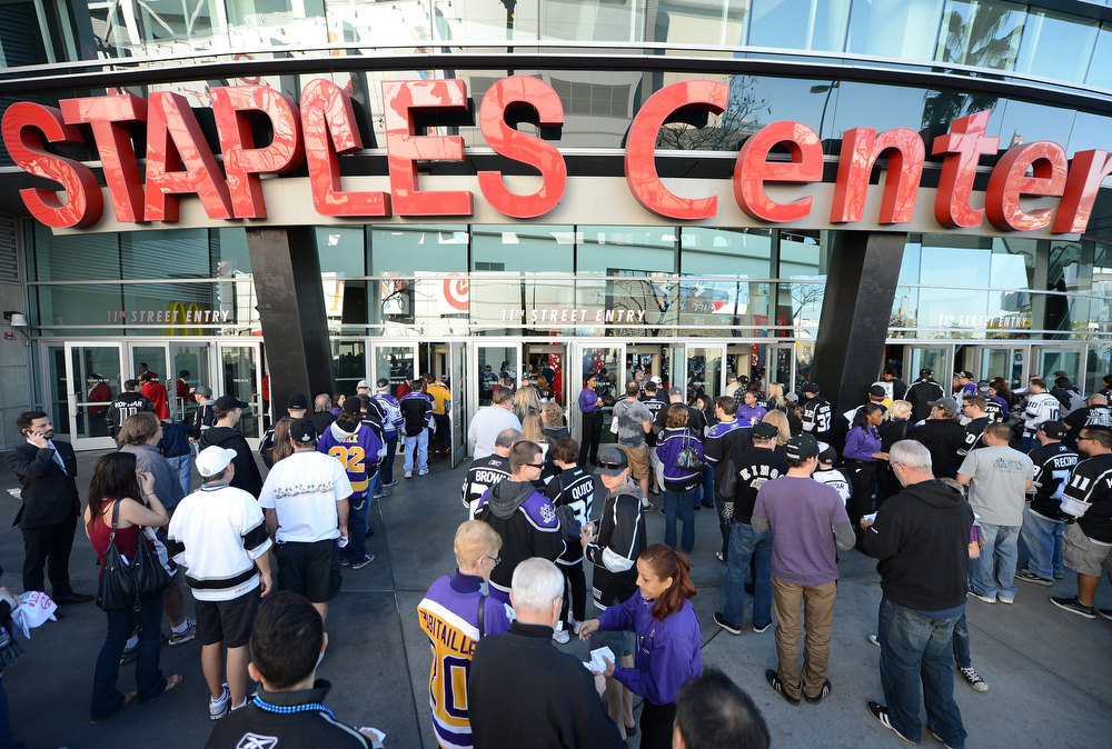 Description of . LOS ANGELES, CA - JANUARY 19:  Fans wait to enter the arena for the NHL season opening game between the Chicago Blackhawks and the Los Angeles Kings at Staples Center on January 19, 2013 in Los Angeles, California.  (Photo by Harry How/Getty Images)