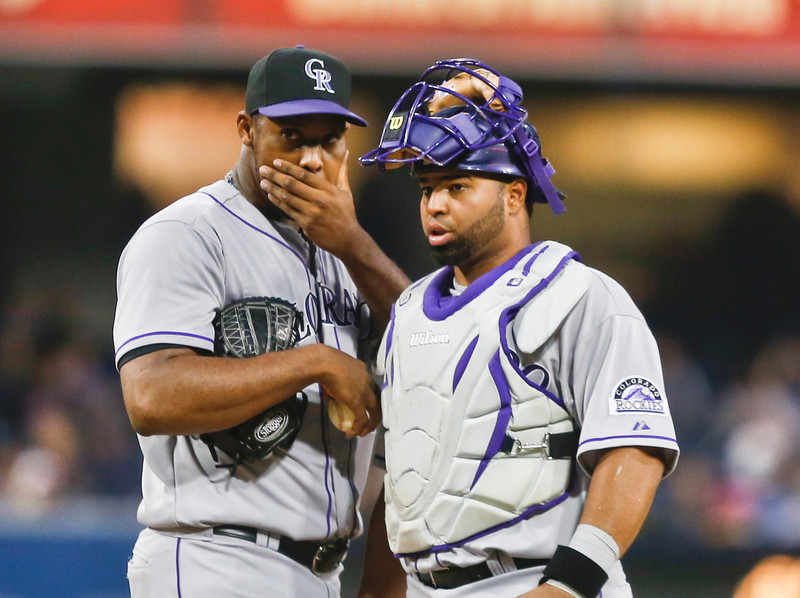 . Colorado Rockies starting pitcher Juan Nicasio and catcher Wilin Rosario have a talk during a long first inning in which  Nicasio gave up two runs to the San Diego Padres in a baseball game Tuesday, April 15, 2014, in San Diego. (AP Photo/Lenny Ignelzi)