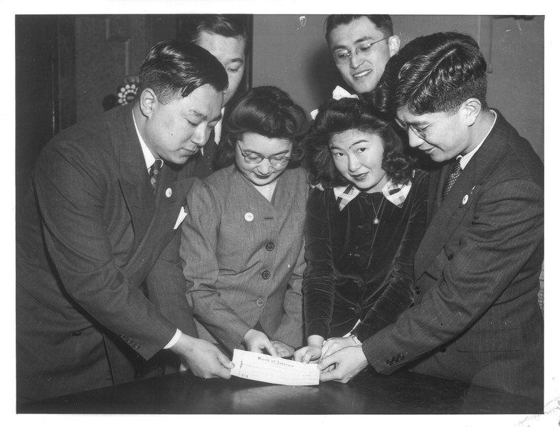 """""""Japanese-Americans Help Bomber Fund"""" -- caption on photograph"""