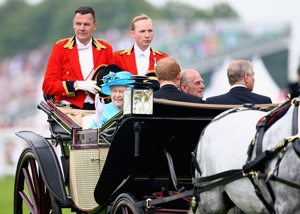 . Queen Elizabeth II and Prince Philip, Duke of Edinburgh during the Royal Procession on day three of Royal Ascot at Ascot Racecourse on June 19, 2014 in Ascot, England.  (Photo by Charlie Crowhurst/Getty Images for Ascot Racecourse)