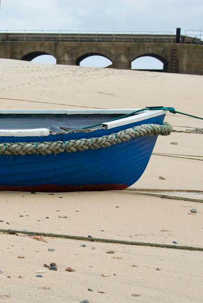 blue boat in sand.jpg
