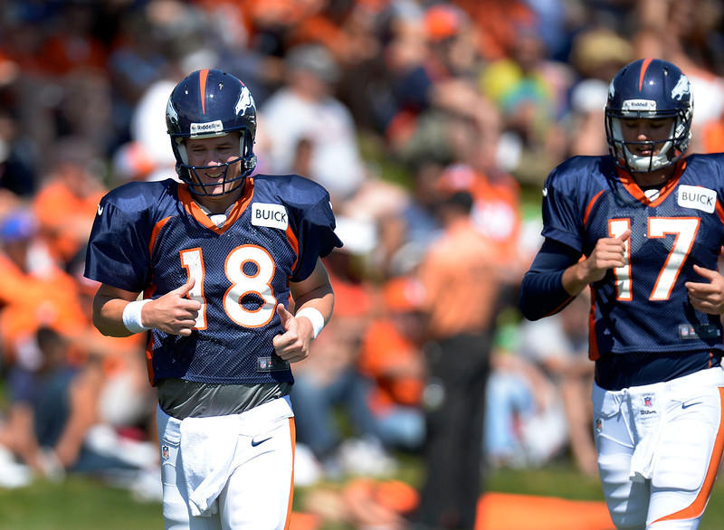 . Denver Broncos QB\'s Peyton Manning (18) and Brok Osweiler (17) head to drills during training camp August 12, 2013 at Dove Valley. (Photo By John Leyba/The Denver Post)