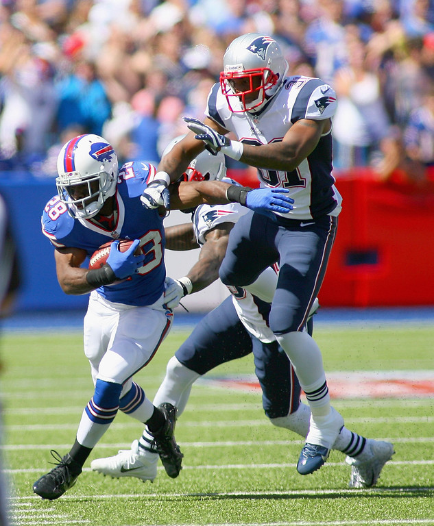 . C.J. Spiller #28 of the Buffalo Bills runs against  Aqib Talib #31 of the New England Patriots at Ralph Wilson Stadium on September 8, 2013 in Orchard Park, New York.  (Photo by Rick Stewart/Getty Images)