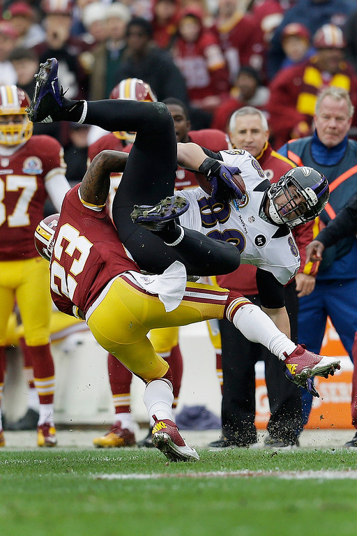 . LANDOVER, MD - DECEMBER 09: Tight end Dennis Pitta #88 of the Baltimore Ravens is tackled by cornerback DeAngelo Hall #23 of the Washington Redskins after catching a first half pass at FedExField on December 9, 2012 in Landover, Maryland.  (Photo by Rob Carr/Getty Images)