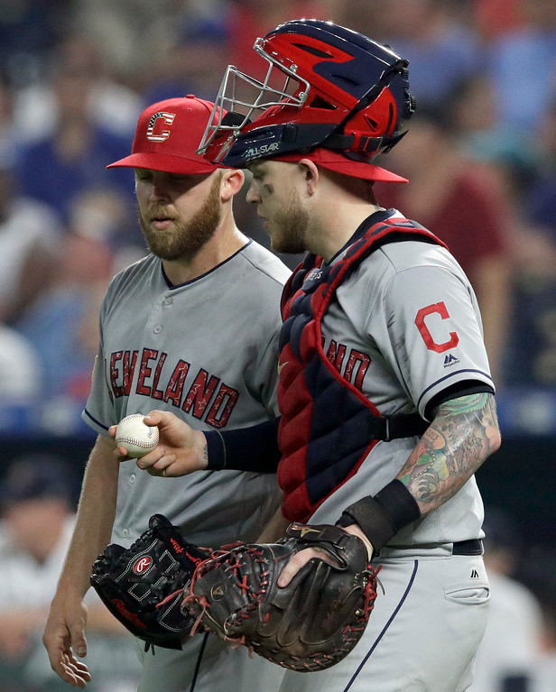 . Cleveland Indians catcher Roberto Perez, right, hands the ball to relief pitcher Cody Allen, left, following a baseball game at Kauffman Stadium in Kansas City, Mo., Wednesday, July 4, 2018. Allen earned the save. The Indians defeated the Royals 3-2. (AP Photo/Orlin Wagner)