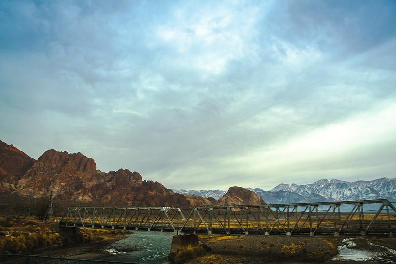 Steel Bridge over Low Andes Desert River