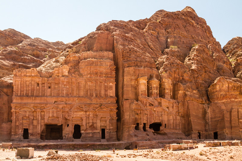 ancient buildings carved into red sandstone