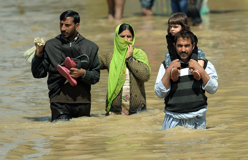 . A Kashmiri family walks through the floodwaters in Srinagar on September 10, 2014.  .  AFP PHOTO/ PUNIT  PARANJPE/AFP/Getty Images