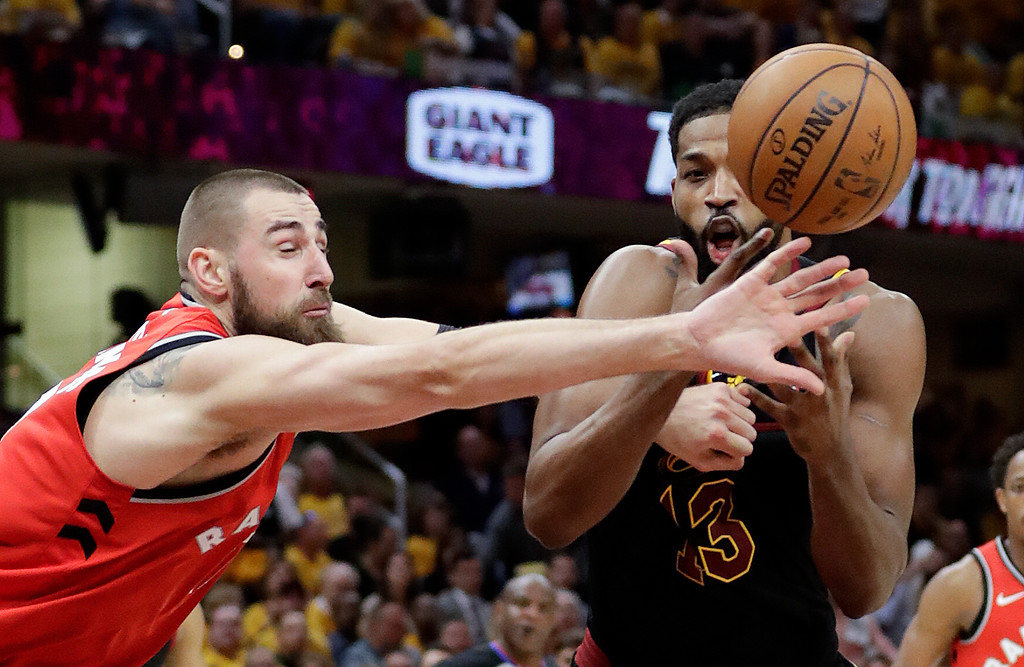. Cleveland Cavaliers\' Tristan Thompson, right, and Toronto Raptors\' Jonas Valanciunas, from Lithuania, battle for the ball in the first half of Game 4 of an NBA basketball second-round playoff series, Monday, May 7, 2018, in Cleveland. (AP Photo/Tony Dejak)