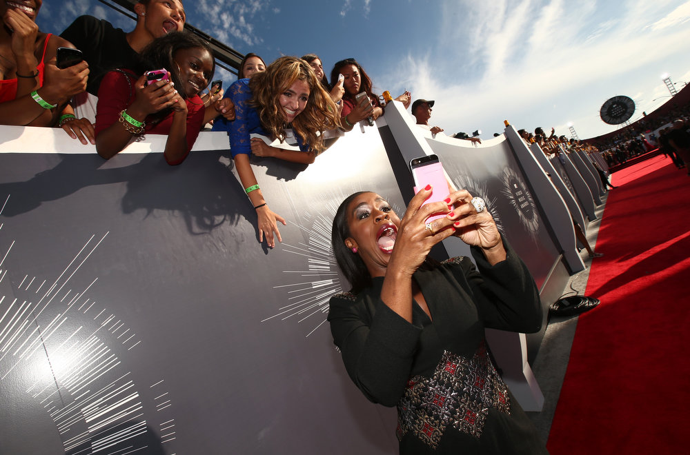 . Actress Uzo Aduba takes a selfie on the red carpet at the 2014 MTV Video Music Awards at The Forum on August 24, 2014 in Inglewood, California.  (Photo by Christopher Polk/Getty Images for MTV)