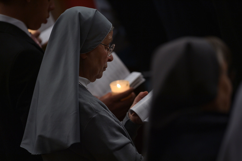 . Nuns attend the Easter Vigil at the St Peter basilica in Vatican. Easter Vigil, also called the Paschal Vigil is a service held in traditional Christian churches as the first official celebration of the Resurrection of Jesus.  AFP PHOTO / FILIPPO MONTEFORTE/AFP/Getty Images