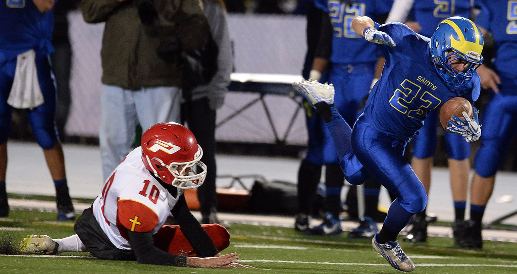 . San Dimas\' Joseph Mayorga (23) runs for yardage past Paraclete\'s Andrew Jimenez (10) in the second half of a CIF-SS Mid-Valley Division championship football game at San Dimas High School in San Dimas, Calif., on Friday, Dec. 6, 2013. San Dimas won 20-14.  (Keith Birmingham Pasadena Star-News)