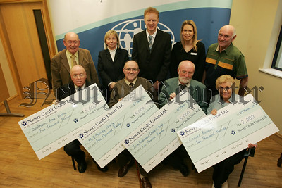 Representatives from the Southern Area Hospice, M.S. Therapy, Irish Handicapped Childrens Trust and Cancer Research recieve Cheques totalling £17000 the proceeds of the recent Panto seris presented by the Panto Players which include, Charlie Smyth, John Cookson and Edel Loughern. 07W13N4