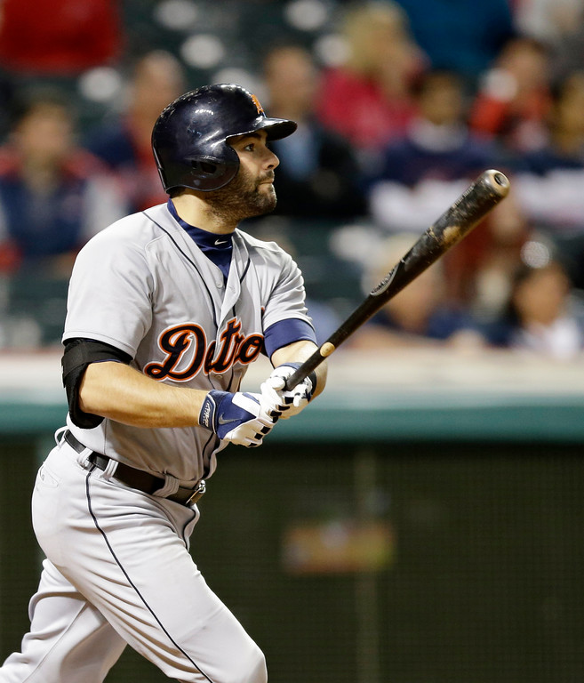 . Detroit Tigers\' Alex Avila hits a double off Cleveland Indians starting pitcher Corey Kluber in the seventh inning of a baseball game, Monday, May 19, 2014, in Cleveland. (AP Photo/Tony Dejak)