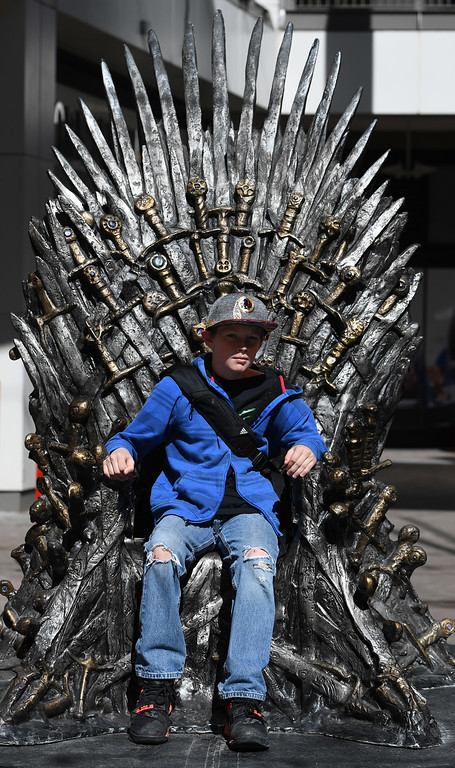 """. DENVER, CO - APRIL 22: Jeremy Berger, 11, from Moffat, CO. The famous seat that characters are battling for in HBO\'s smash hit \""""Game of Thrones\"""" is now on display in the Denver Pavilions in downtown Denver for fans to pose and take pictures with for free leading up to the premiere of the show\'s sixth season on Sunday. (Photo by Kathryn Scott Osler/The Denver Post)"""