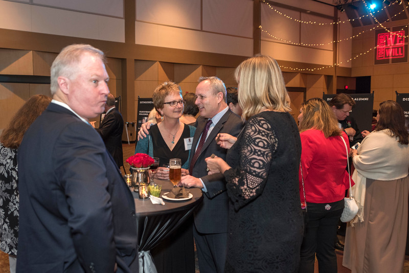 Guests and honorees enjoy the Distinguished Alumni Dinner on Friday, March 24, 2017 in Chico, Calif. (Jason Halley/University Photographer)