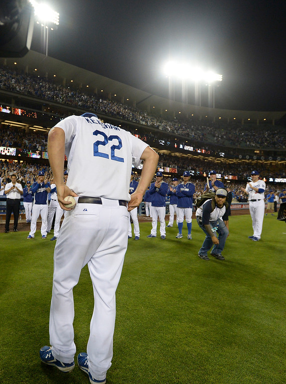 . Carrying the ball from his final pitch, Clayton Kershaw walks from the field after he threw a no hitter. The Dodgers defeated the Colorado Rockies 8-0 at Dodger Stadium in Los Angeles, CA. 6/18/2014(Photo by John McCoy Daily News)