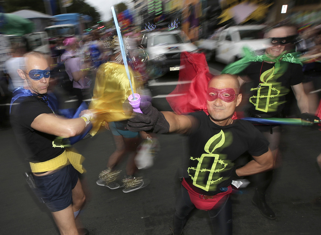 . Parade participants celebrate Mardi Gras in Sydney, Australia, Saturday, March 2, 2013. 10,000 are marching along side 115 floats in the annual parade that celebrates lesbian and gay pride. (AP Photo/Rick Rycroft)