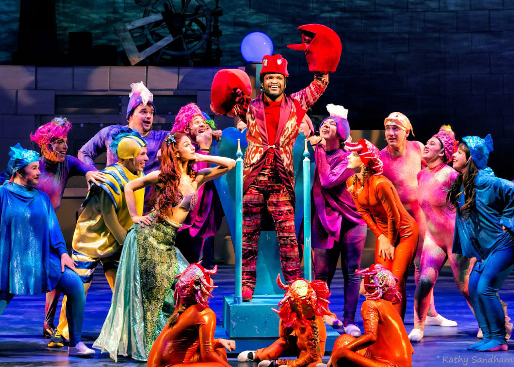 . Wesley Allen as Sebastian, center, Kathleen Rooney as Ariel, left center, and the cast in a scene from the Beck Center production of �The Little Mermaid.� The show continues through Dec. 31. For more information, visit