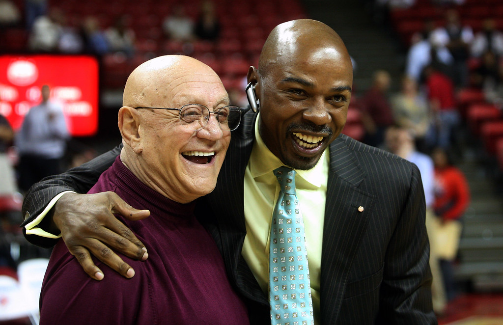 . Former Las Vegas basketball coach Jerry Tarkanian, left, greets former player Greg Anthony, right, after the UNLV Alumni game on Tuesday Nov. 7, 2006, at the Thomas & Mack Center in Las Vegas. Anthony, who was part of Tarkanian\'s 1990 national championship team, will have his jersey retired at halftime of the UNLV and Dixie State exhibition game. (AP Photo/Marlene Karas)
