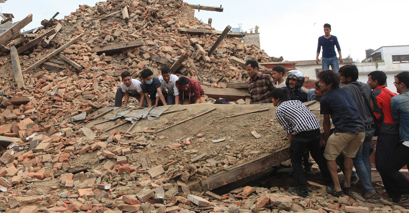 . Rescuers try to take out the debris from a temple at Hanumandhoka Durbar Square after earthquake in Kathmandu, Nepal, April 25, 2015. More than 100 people are so far known to have been killed in a strong earthquake which hit large parts of Nepal on Saturday, including dozens in capital Kathmandu, sources here said. (Xinhua/Sunil Sharma)