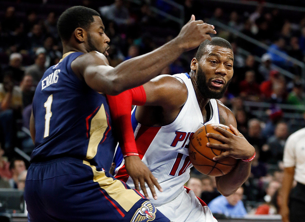 . Detroit Pistons forward Greg Monroe (10) drives on New Orleans Pelicans guard Tyreke Evans (1) during the first half of an NBA basketball game in Auburn Hills, Mich., Wednesday, Jan. 14, 2015. (AP Photo/Paul Sancya)