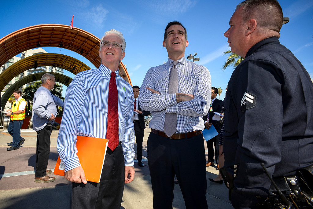 . Councilmember Paul Krekorian, left, and Los Angeles mayor Eric Garcetti visit with North Hollywood Metro station as LAPD Senior Lead Officer John Catalano at the station on Monday, March  17, 2014.   ( Photo by David Crane/Los Angeles Daily News )