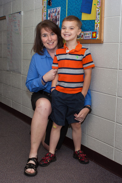 K.C. and Mrs. Bushnell outside his classroom.