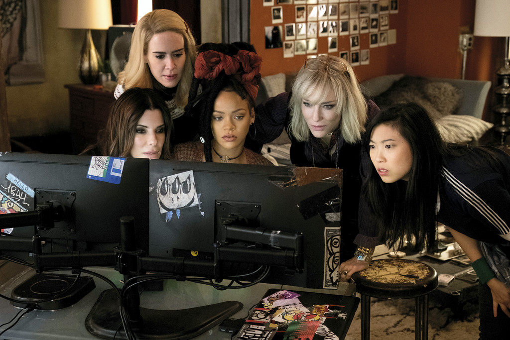 ". This image released by Warner Bros. shows, from foreground left, Sandra Bullock Sarah Paulson, Rihanna, Cate Blanchett and Awkwafina in a scene from ""Ocean\'s 8.\"" The movie is in theaters June 8. (Barry Wetcher/Warner Bros. via AP)"