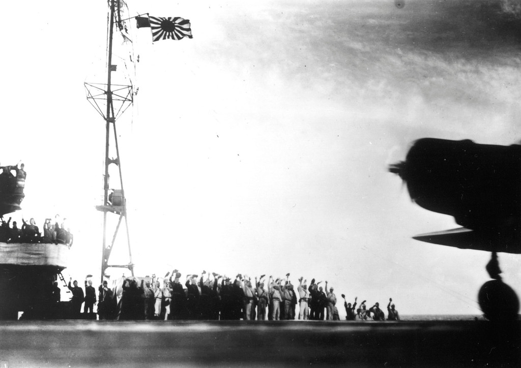 ". This photograph, from a Japanese film later captured by American forces, is taken aboard the Japanese aircraft carrier Zuikaku, just as a Nakajima ""Kate\"" B-5N bomber is launching off deck for the second wave of the attack on Pearl Harbor, Hawaii, on December 7, 1941. (AP Photo)"