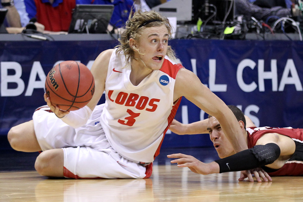 . Hugh Greenwood #3 of the New Mexico Lobos slides to grab a loose ball against Dwight Powell #33 of the Stanford Cardinal in the second half during the second round of the 2014 NCAA Men\'s Basketball Tournament at Scottrade Center on March 21, 2014 in St Louis, Missouri.  (Photo by Andy Lyons/Getty Images)