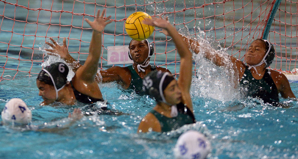 . Eagle Rock High School\'s goalie Jahmea Bent blocks a shot during their City Section girls water polo final against Palisades Charter High School at the Contreras Learning Complex in Los Angeles Thursday, February 27, 2014. (Photo by Hans Gutknecht/Los Angeles Daily News)